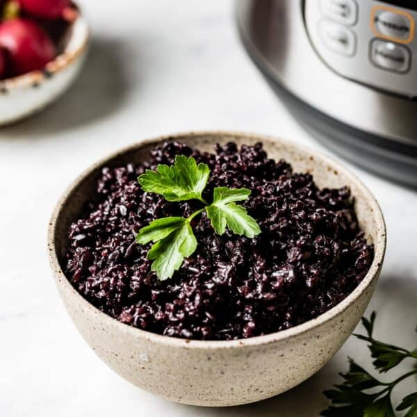 Instant pot black rice in a bowl from the front