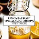 Lemon balsamic salad dressing in a bottle with text on it.