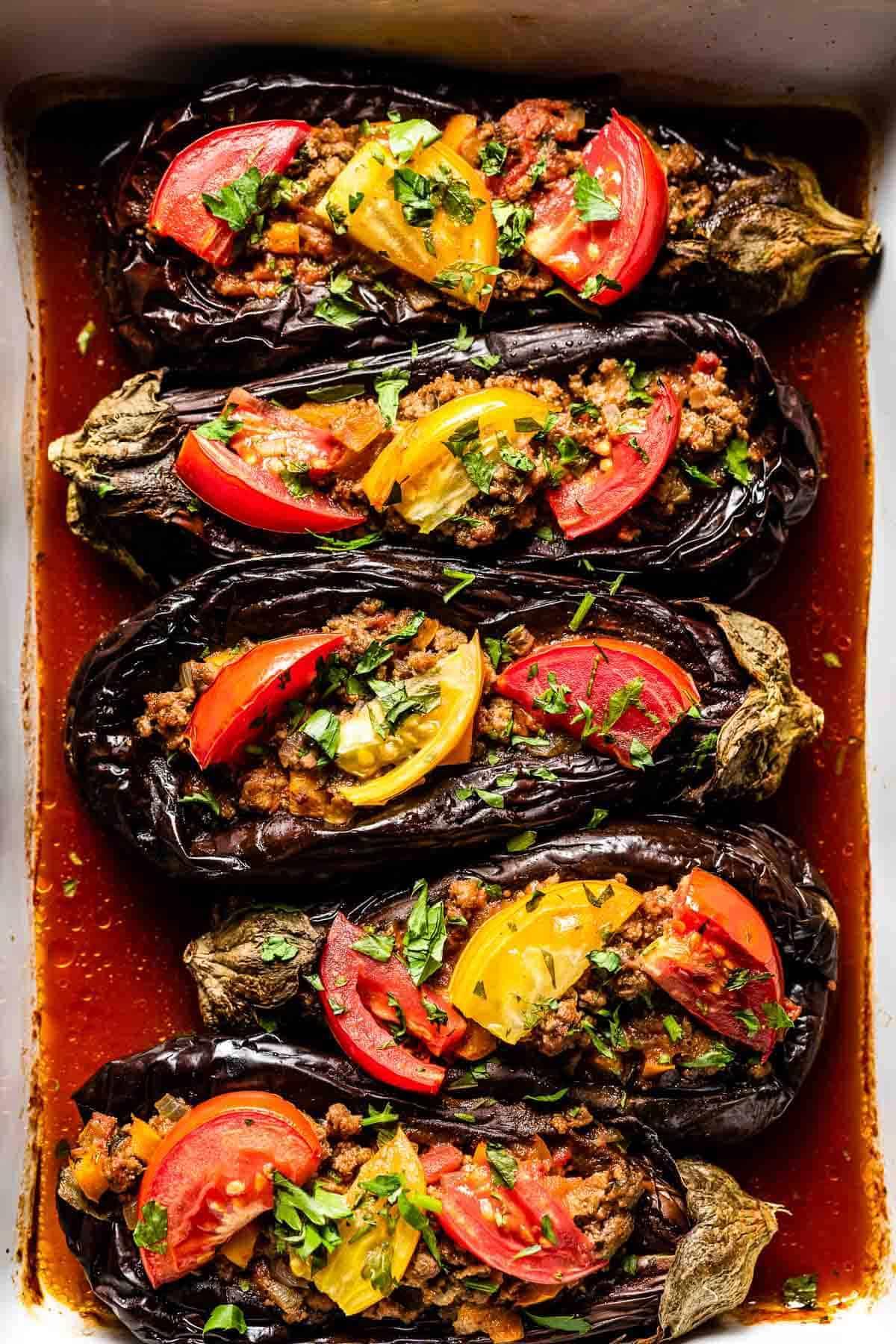 Karniyarik recipe garnished with tomatoes and parsley