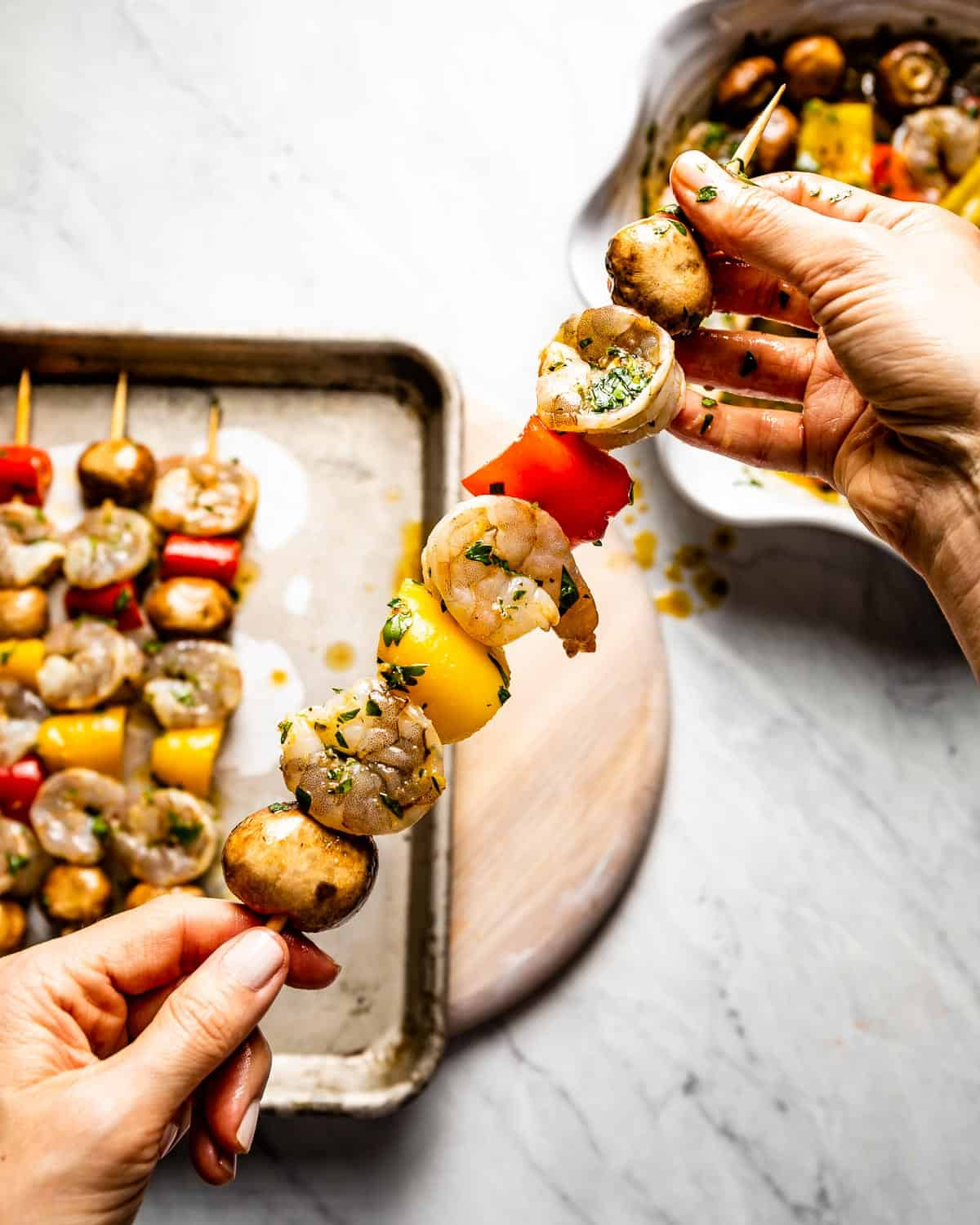 Person showing how to thread skewers for Shrimp Shish Kebabs