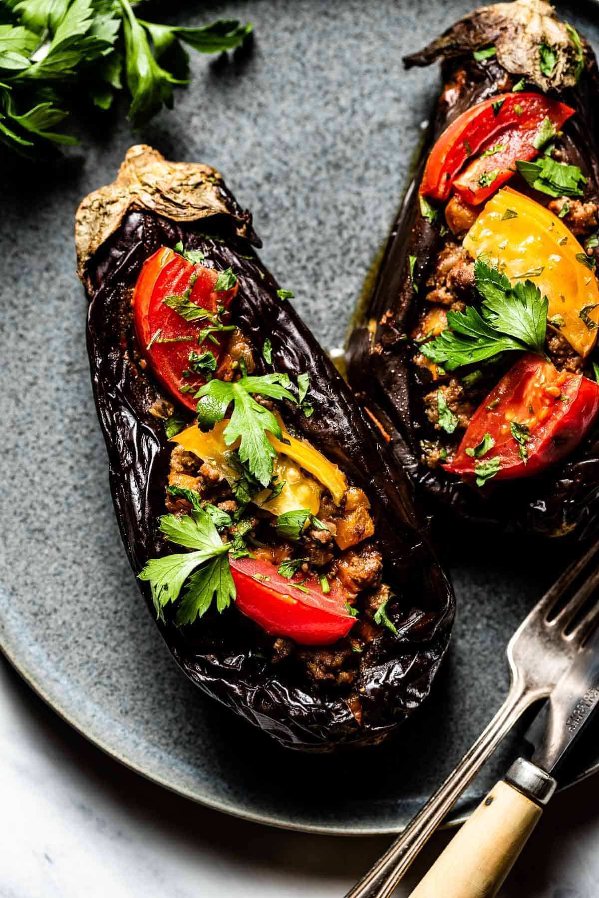 Turkish baked eggplant filled with ground beef served on a plate