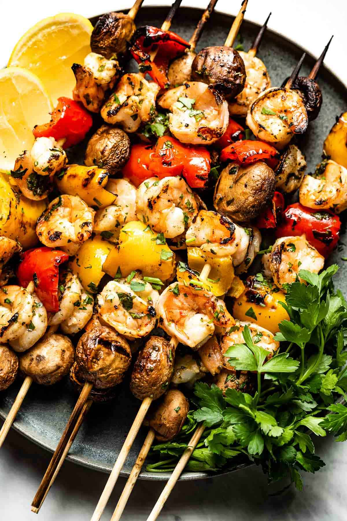 Grilled Shrimp Skewers with vegetables on a plate.