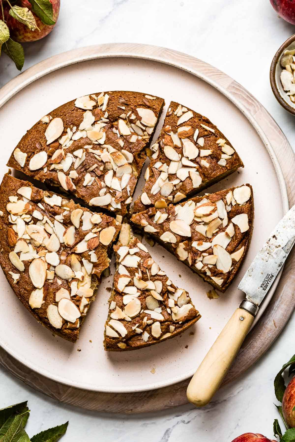 Paleo Gluten Free Apple Cake with almond flour sliced on a plate top view