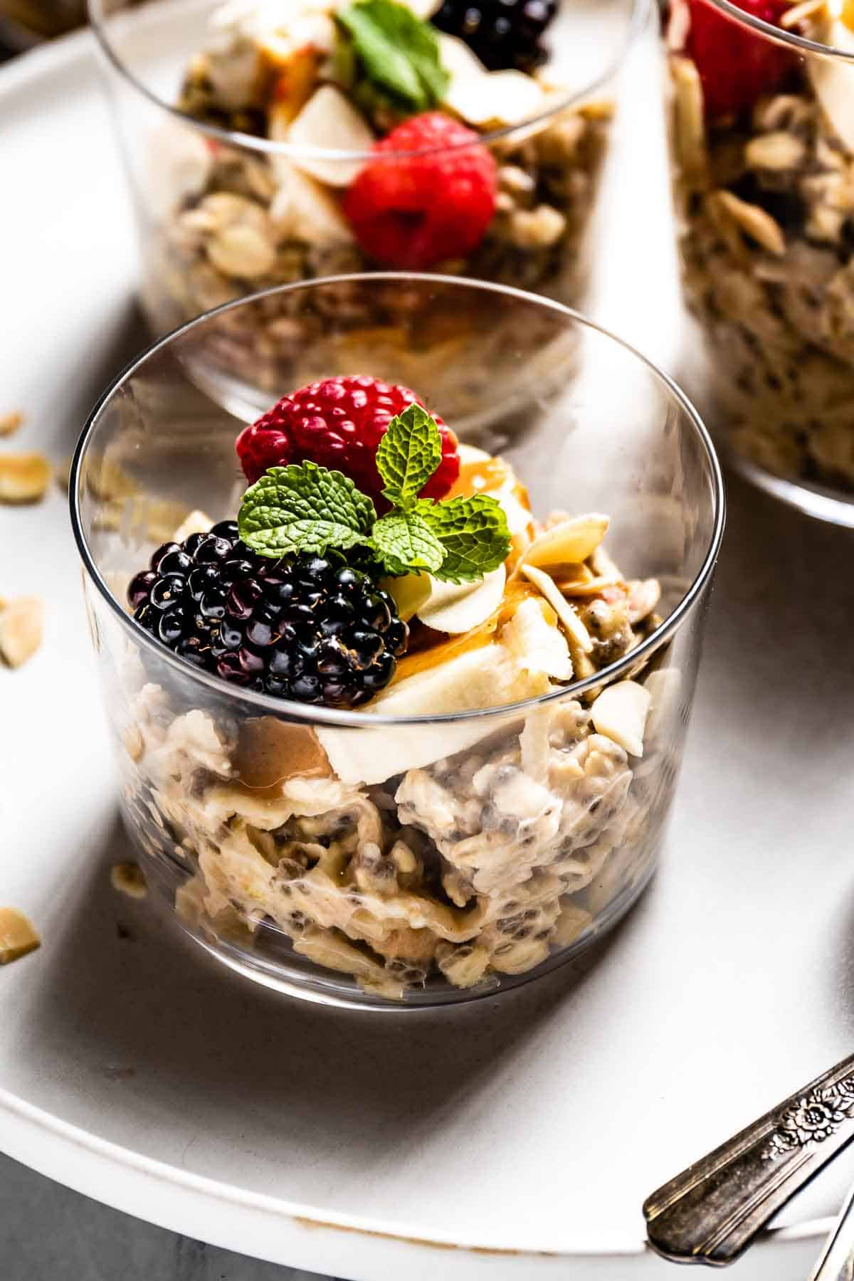 Overnight muesli in a glass garnished with fruit