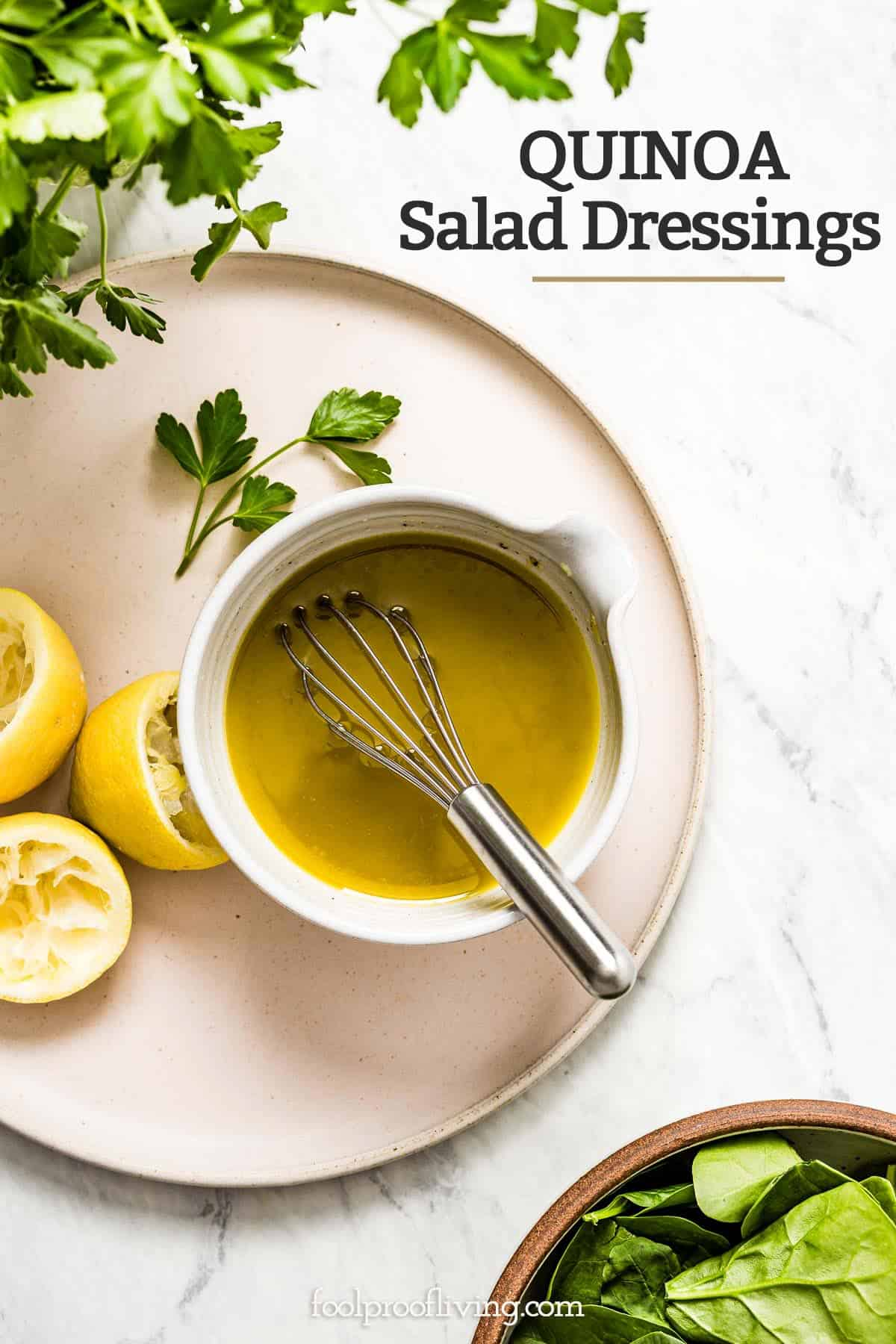 a bowl of lemon vinaigrette with a whisk in the bowl