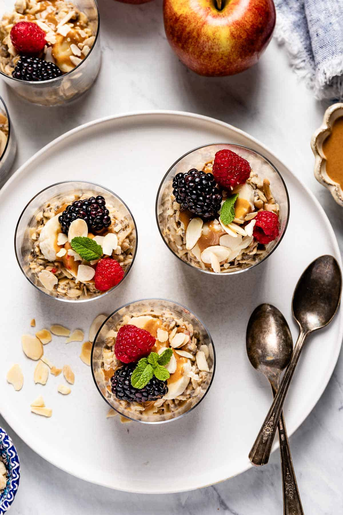 Muesli yogurt breakfast in glass topped off with fruit from top view